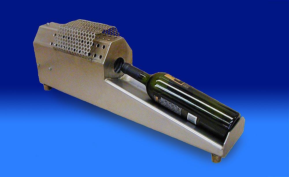 Fotografía de capsulador termocontraíble